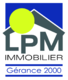 Agence LPM Immobilier - Gérance 2000 Sàrl - Commercial area with large windows located in the center of the villag